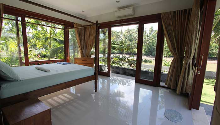 Guest house bedroom looking to Balian river